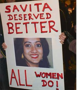 Placard beeing held up with an image of Savita Halappanavar along with the words 'Savita Deserved Better, all women do!'