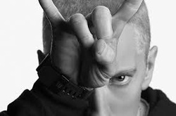 Black and White photo of eminem making the horns sign with his hand on his forehead
