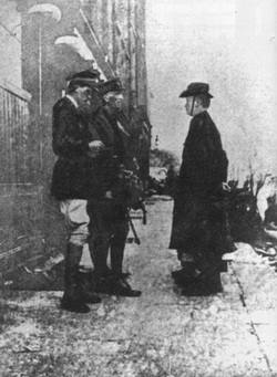Black and White Photograph od Padraig Pearse, General Lowe and one other figure.